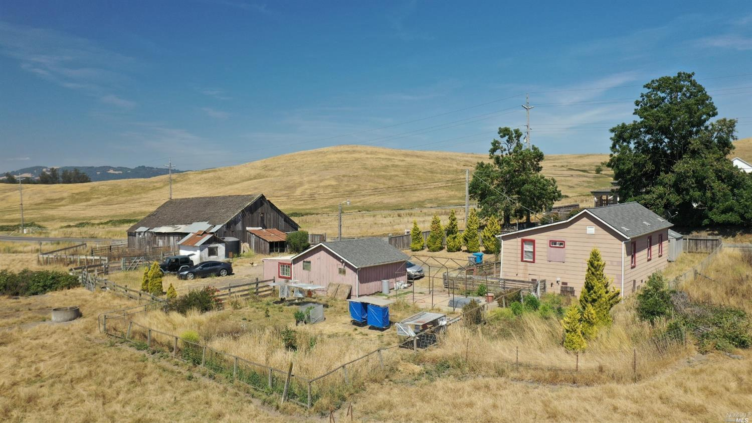 Location,location! Close in 48 acre ranch property under Williamson Act, owner help with some financing to a qualified buyer, farmhouse  with detached 2 car garage, large barn creek running through the property. Great for horses, cattle & future investment.
