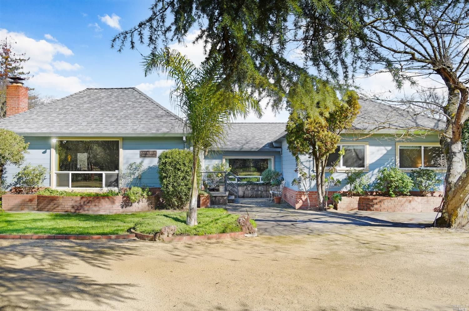 Close to downtown Sonoma, and only a short distance to a handful of world renowned wineries.  This beautiful mid century ranch home on 1.85 acres offers 2,112 sq. ft. of comfortable living space with three bedrooms, two and a half baths, an updated central heat and AC system, and a 950 sq. ft. attached garage/shop.  Features include a 2,000 sq. ft. outdoor BBQ area, 320 sq. ft. steel storage structure with freezer room and car port, 400 sq. ft. animal shelter with fenced gated areas, poultry aviary, and a custom built smoke house. Direct access to both Leveroni Rd. and Harrington Dr. adds to the multiple uses of this unique property. Plenty of usable space and multiple outbuildings make this the perfect property for gardening, a vineyard, s