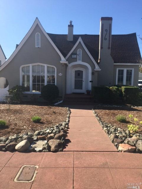 Iconic Tudor style home features 2 BD/1.5 BA. Formal entry leads to Living Room with vaulted ceiling