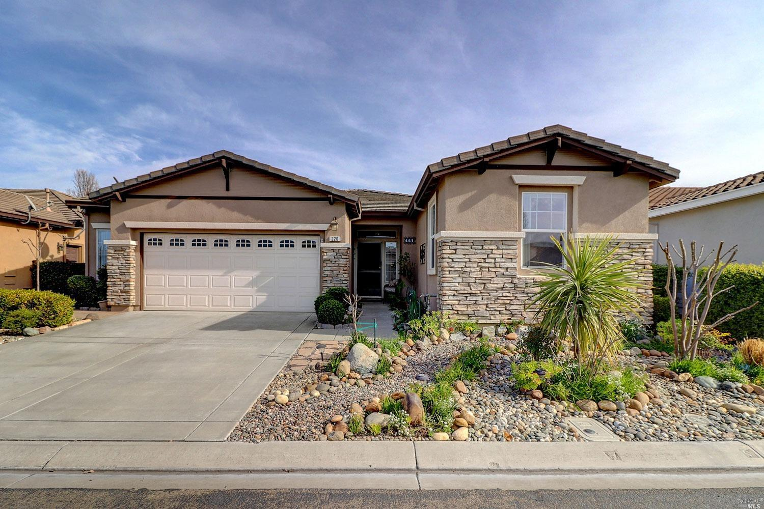 This remarkable Hillsborough model on a spectacularly landscaped lot offers bright and delightful in