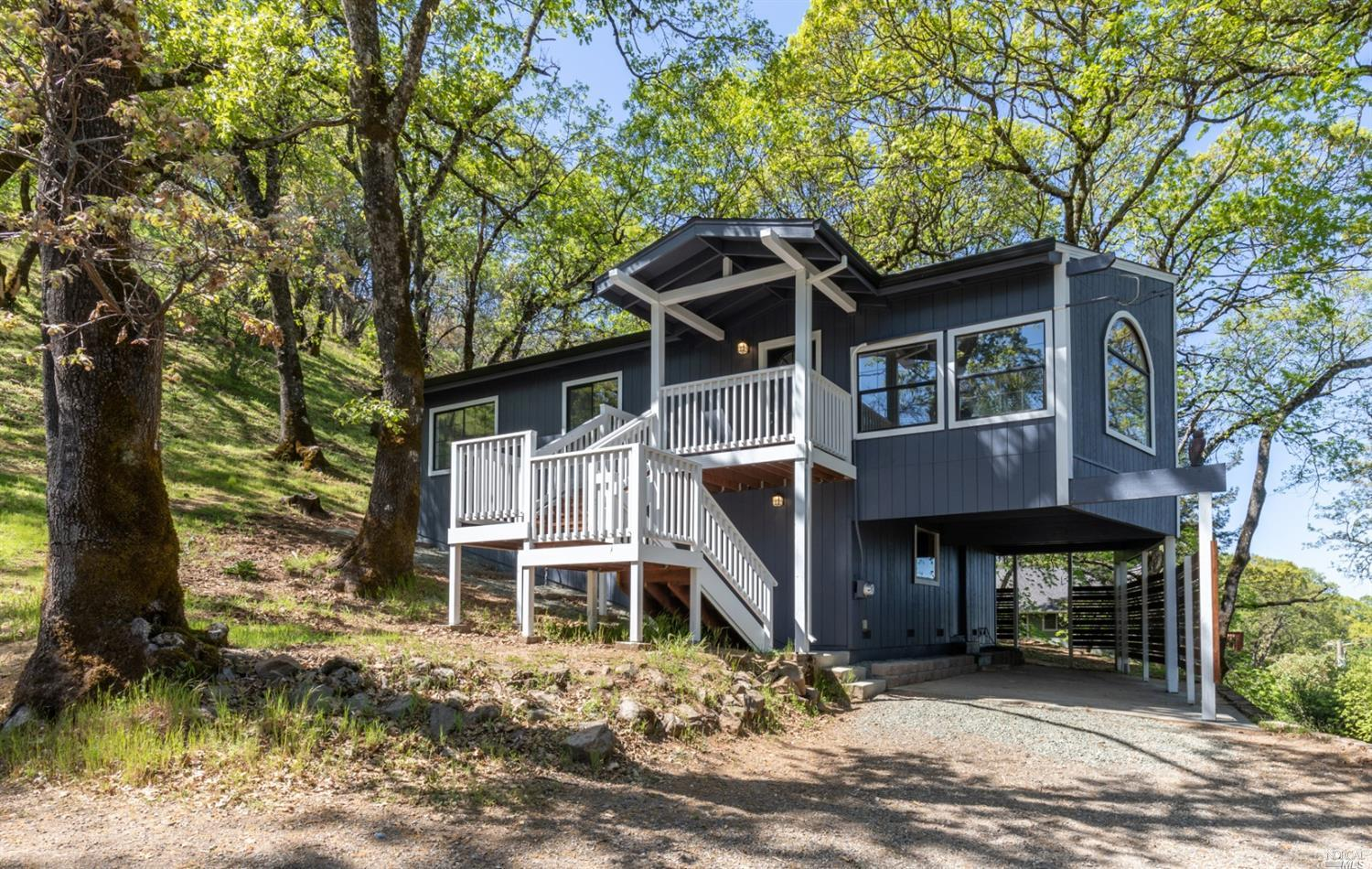 This remodeled 1,319sqft, three-bedroom country residence is perched atop a gentle hill amongst oak