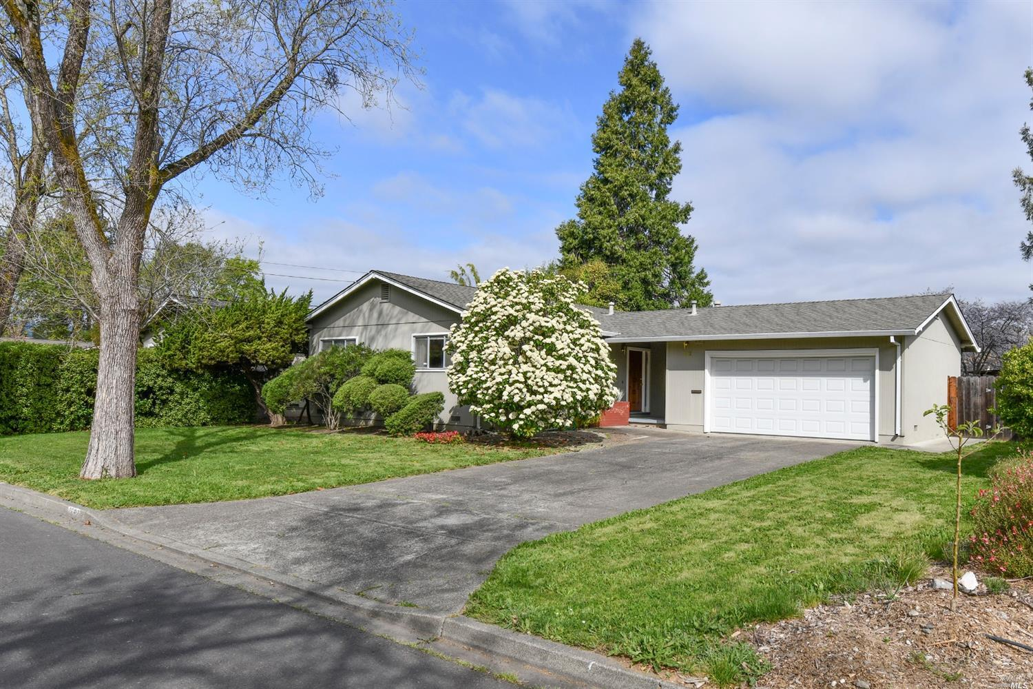 On a quiet street in an established neighborhood, this Well maintained North Napa BelAire home sits
