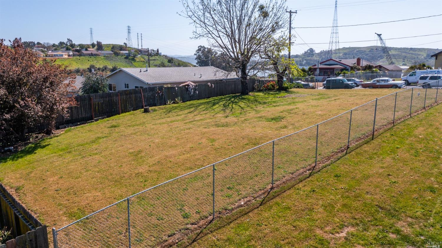 Corner lot with water views! Zoned low-density residential with potential for detached ADU and attached Junior ADU.