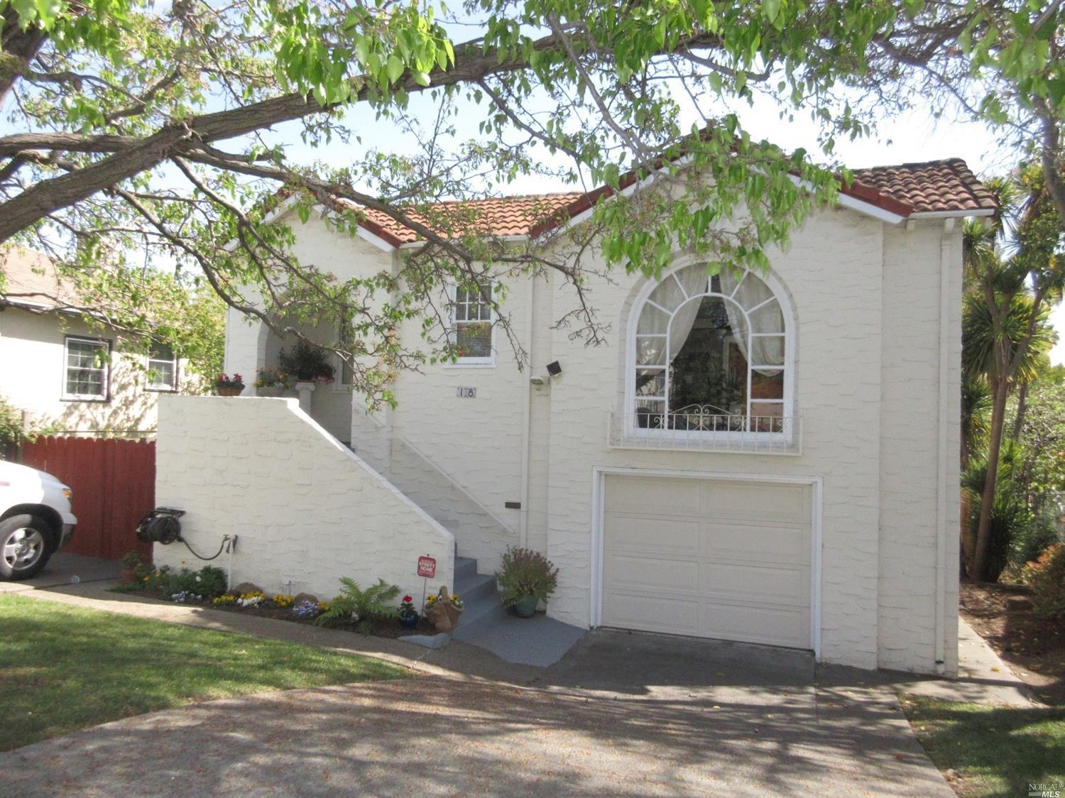Lovely Vintage home with modern amenities woven in with subtlety. The original 2-bedroom, 1-bath hom