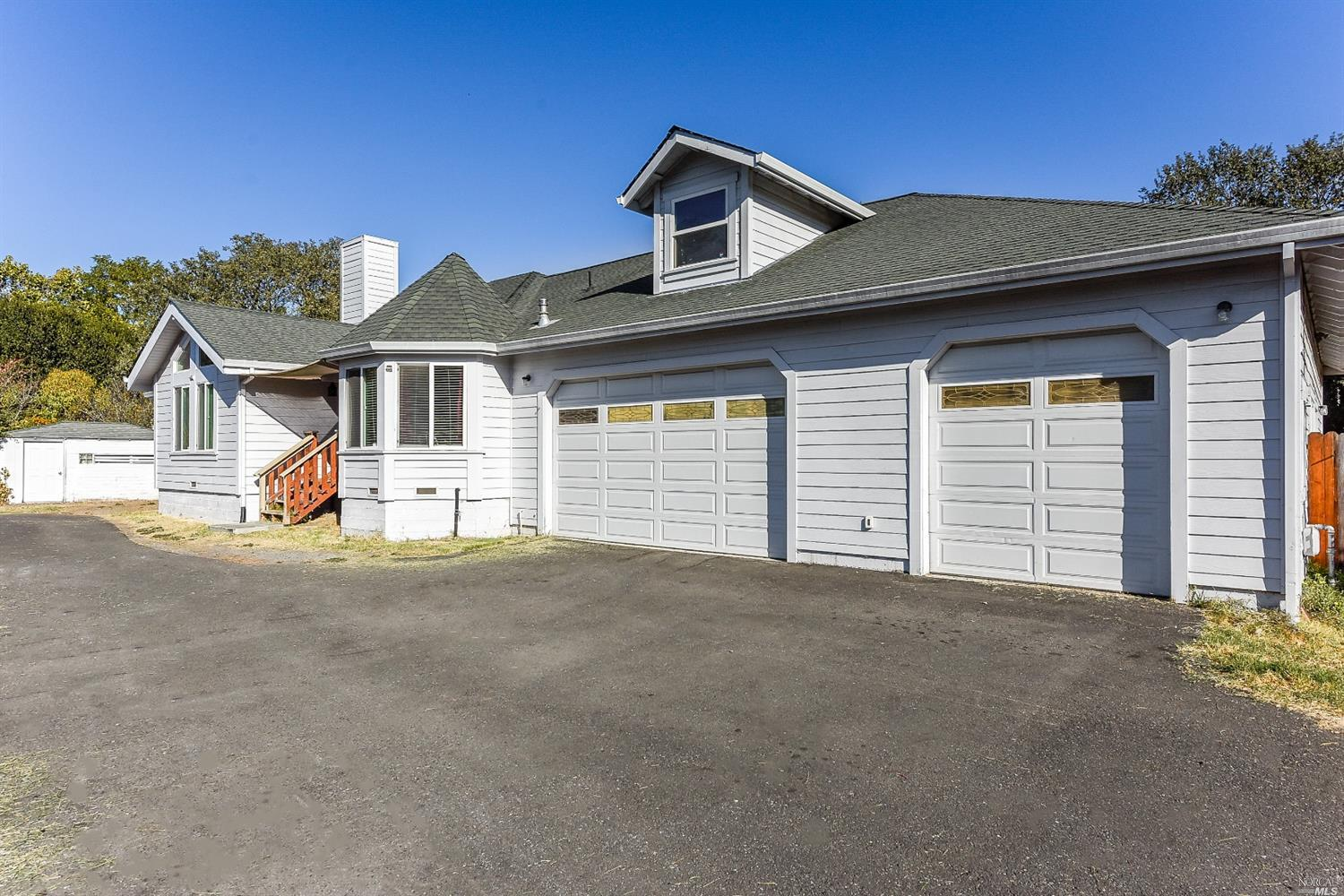 Hard to find spacious living in Santa Rosa, kitchen with granite counters, 3 car garage, in town location with a country setting on a large lot, yet minutes to Shopping and commuter access, beautiful 6 bedroom home! Imagine the possibilities: extended family, etc.etc.etc. you decide!