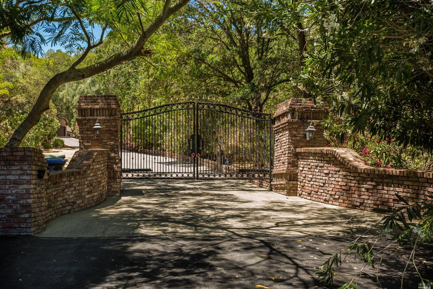RARE OPPORTUNITY! This grand home is located at the very back of Green Valley on five lush acres. Be