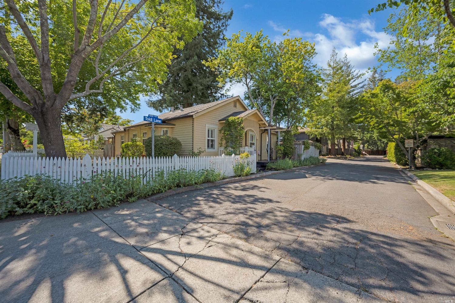 New Listing! Open this weekend! Charming, cheery and bright 1940's cottage with white picket fence,