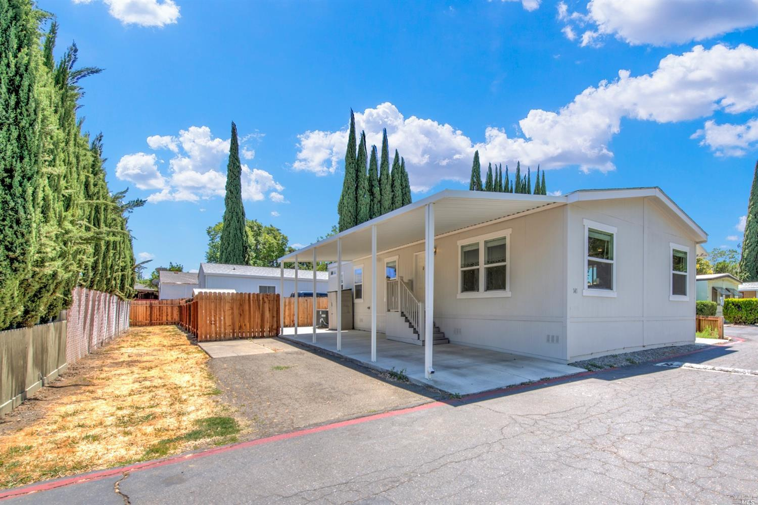 Fall in love with this 2018, 3 bedroom 2 bathroom spacious Double Wide Manufactured Home. Located on a Premium Corner Lot, filled with lots of natural light. This Manufactured home features a open concept Living room, Dining room and Kitchen combo great for entertaining family and friends. Kitchen features granite countertops, double stainless steel sink, white appliances, lots of cabinetry and island (refrigerator included), with beautiful vinyl flooring. Huge Master suite and bathroom. Large indoor Laundry room, washer and dryer included. The Park Features a Playground, Clubhouse, Swimming Pool and Recreational Facilities.