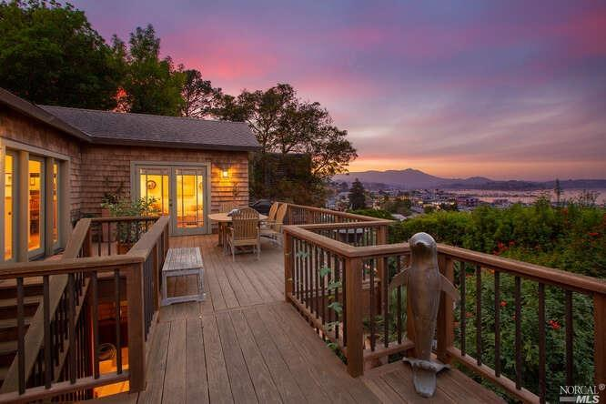 Ideal location!Close to the ferry,this hidden, private home is heartbreakingly charming with one of the best panoramic views!Tranquil,beautiful gardens are your first glimpse into how special this home is.Enter the spacious entry deck & get your first look at the amazing Bay, marina & Mt.Tam views! Windows & French doors abound along entire front of the home, taking advantage of the spectacular vistas.The Living area features a good-sized open kitchen with French doors leading to the deck.Bedroom on upper level has 2 large closets.The stylish bathroom has a beautifully tiled,jacuzzi tub/shower & plenty of cabinet space. Room off the garden is great as a guest bedroom or office(or both),with abundance of storage behind this room.Large covered patio is perfect for an outdoor gym.Large utility/laundry room could be ideal space to create a workshop,craft area or to provide additional storage.Weather in this area is one of the best in Sausalito.Like being on vacation every day!