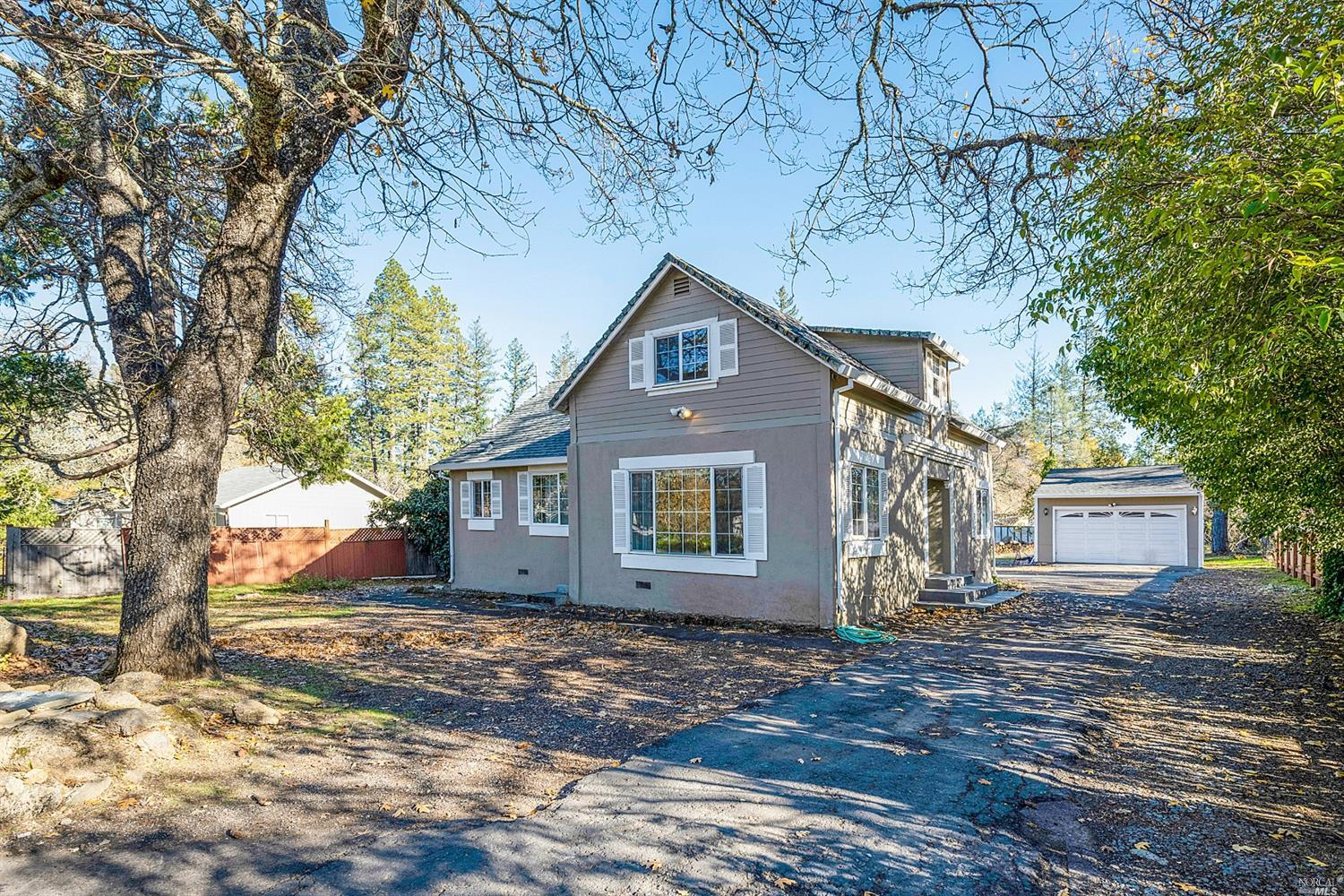 This charming 4b/2.5 bath home cottage rests on 0.45 acres on a quiet street in Angwin, just minutes from the College Market and Pacific Union College. Well maintained with several upgrades including new granite kitchen counters and new carpet in the master bedroom. The 1B/1B guest or rental house provides additional value.In addition the home includes central heating and AC and a detached 2 car garage. Enjoy country living just 15 minutes from the shopping and restaurants of downtown St. Helena. Great location!