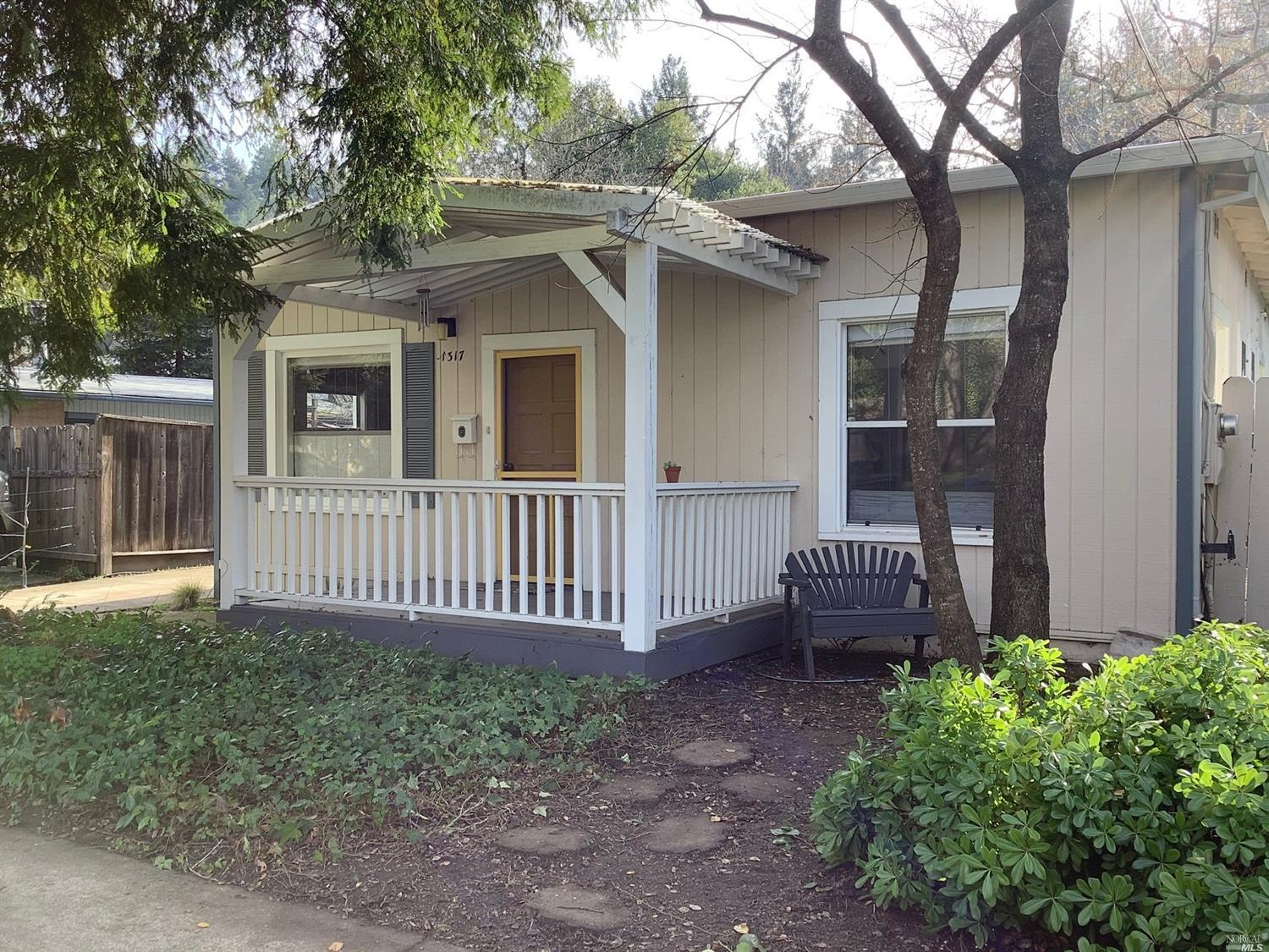 Heres your chance to own a Calistoga Bungalow just 2 blocks from downtown. This 2 bedroom, 2 bath, 1170 sq.ft home has a  large living room w/ wood burning fireplace and hardwood floors throughout, spacious kitchen with simulated stone counters and painted cabinets. Newer roof and gutters and a detached 1 car garage with an attached work shop that could possibly be an ideal ADU unit, check w/ City of Calistoga Planning Dept. A lot of the properties on Myrtle Street are undergoing remodeling or complete renovations/rebuilding. Property is zoned R3 and a majority of the value is in the land and water and sewer hookups.