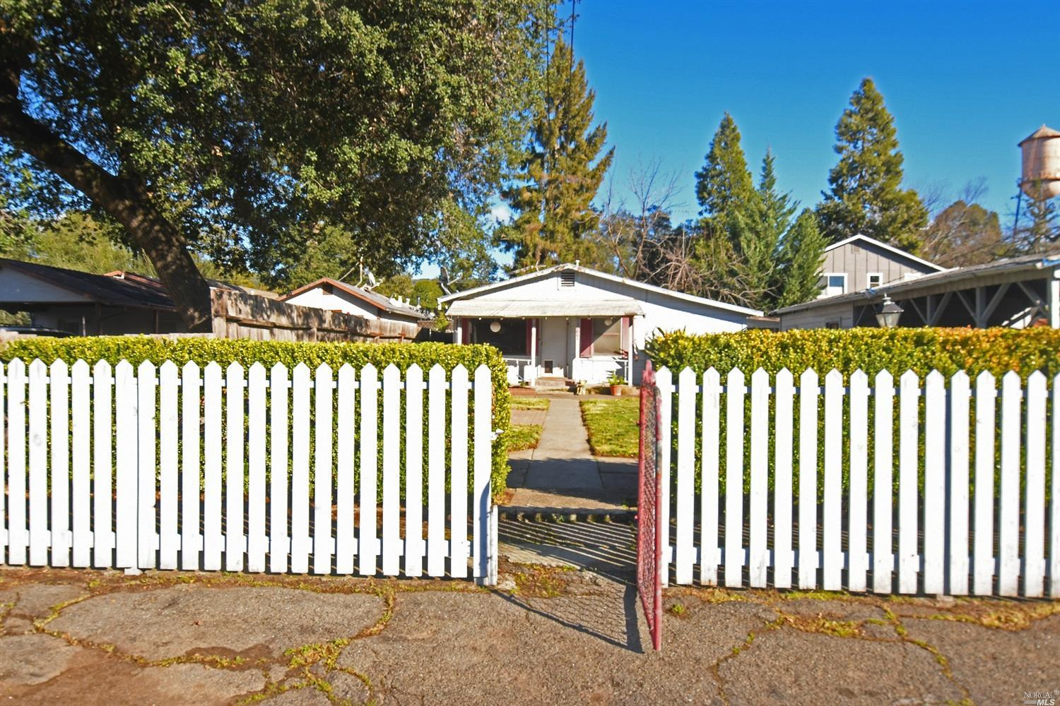 Sweet Boyes Hot Springs fixer with tons of potential! Covered carport, shed, workshop all set back off of the street allowing for plenty of room for expansion. Claw foot tub, new water heater, laundry room detached.  Bring your contractor and vision for this darling bungalow. Enjoy a short stroll to the world famous Sonoma Mission Inn, local restaurants, coffee shop and grocery stores.   Yours to love.....