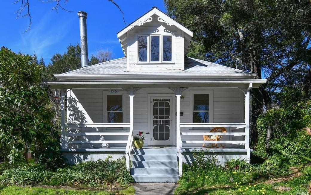 Welcome to the charm of Calistoga. Built in 1910 and conveniently located a short distance to downtown over a footbridge above the Napa River. The home sits at the end of a cul-de-sac across from Pioneer Park. This home offers a wonderful opportunity to make your own improvements. So much potential.  Three bedrooms and two baths downstairs and a spacious upstairs bedroom/loft.  The front porch offers a great space to relax and enjoy Napa Valley life and listen to music during the Farmers Market. Sizable unpaved driveway and small storage/shed.
