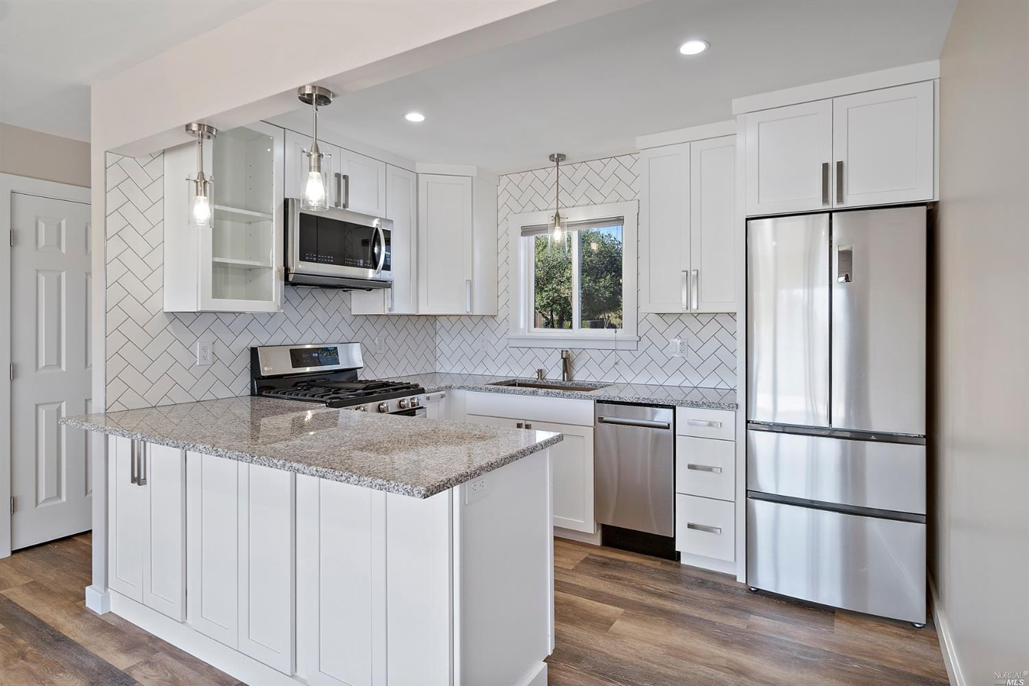 Stunning remodel with great attention to quality and detail. Two bedrooms and an office. Kitchen/living with fireplace and views to the back and beyond. Situated on an 8,500 sq. ft. lot with open space adjacent and behind.  Wonderful country feel ready for you to enjoy.