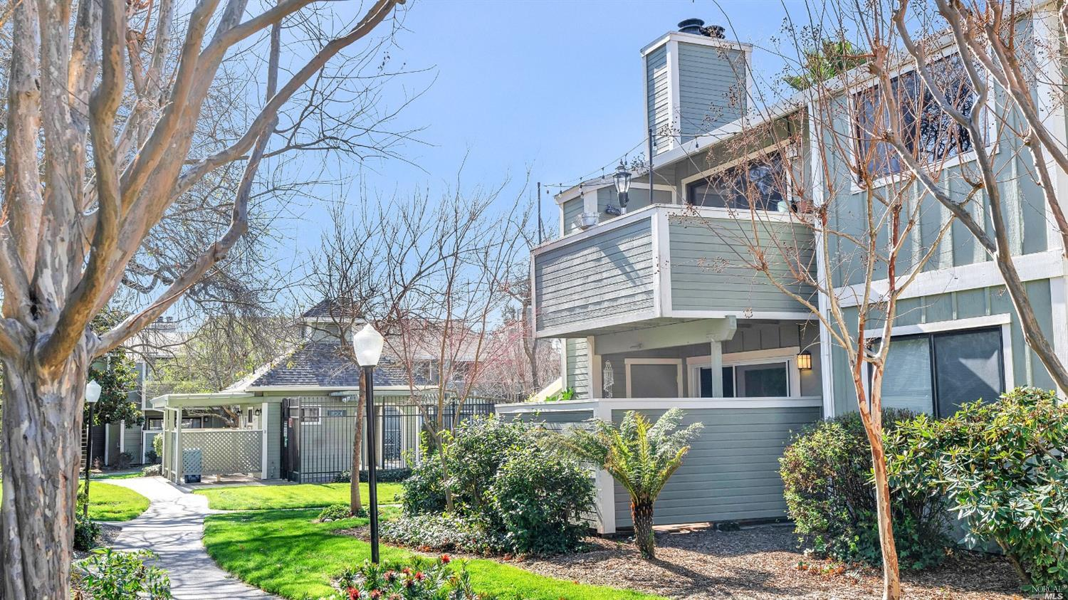 Thoughtfully updated with granite counters, wood floors, barn doors, and multiple shower heads in the 2 full bathrooms! One of the best locations in the community close to parking and to the pool. This one is gorgeous!