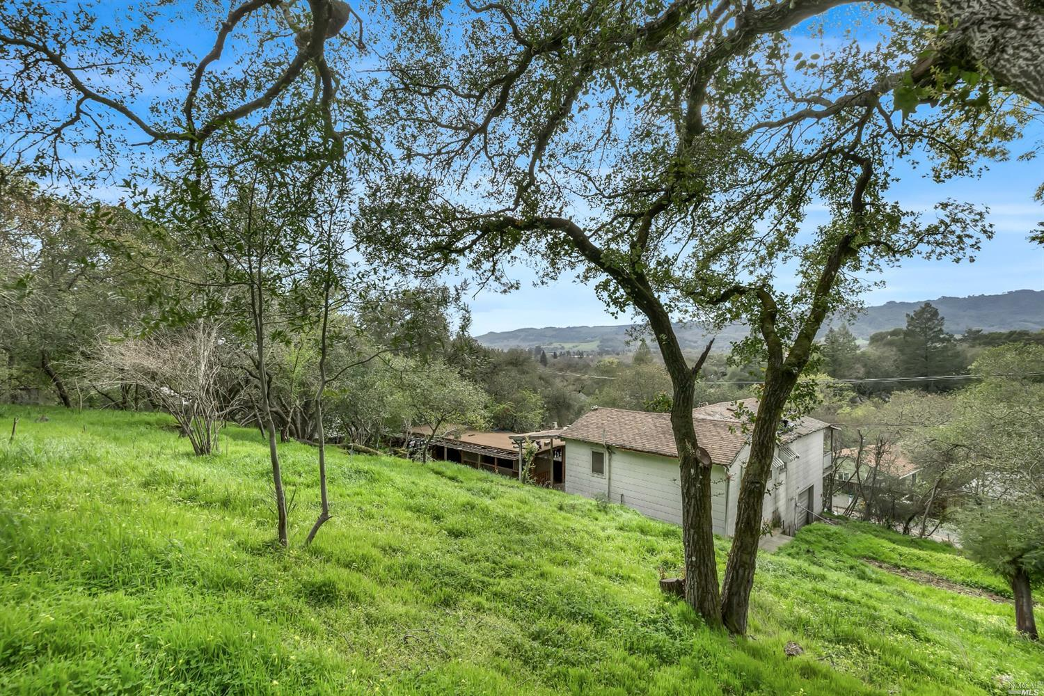 Discover this rustic home site in the heart of Sonoma's lively Springs community. Rich with culture, community, and everything we love about living in the wine country. Located down a quiet and charming street come see this fabulous parcel in an established neighborhood with serene views. Parcel has an existing 1008+/- sq ft structure on at 25,500+/- sq foot lot. Plenty of space to create your custom home with amenities to suit your needs and lifestyle. Existing home which was one a charming country home is past its useful life and ready to be laid to rest. Public utilities are at the build site. Just waiting you to bring your blueprints and bulldozer. Property being sold as land value only and structure is not habitable.