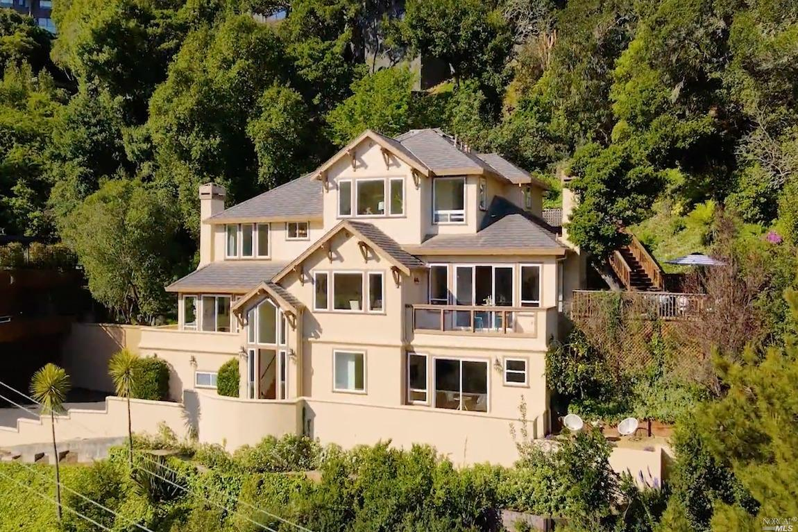 Elegant home with Richardson Bay & Sausalito Harbor Views! Secluded on~0.28 acres yet conveniently located on one of the walkable  Sausalito streets. Seamless indoor/outdoor flow w/sunny front, side & back patios for enjoying authentic Marin living. Thoughtful floor plan. Generous proportions, vaulted ceilings & great natural light. Two separate living/family rooms w/views, fireplaces & access to view decks. Stylish dining room w/views to finally gather with loved ones. Open chef's kitchen w/granite countertops, massive center island, Viking appliances, butler pantry & wine cellar. Breakfast nook w/access to outdoor kitchen & sunny patio. Spacious guest quarters on entry level. En-suite bright BR/office w/views & walk-in closet. 3 generously sized BRs upstairs. Luxurious owner's suite  w/blue water views, spa-like bathroom & steam shower, walk-in closet & fireplace. Serene patios, gardens & greenery all around. 3-car garage. Close to town, parks, trails, ferry, 101 & the GG Bridge!