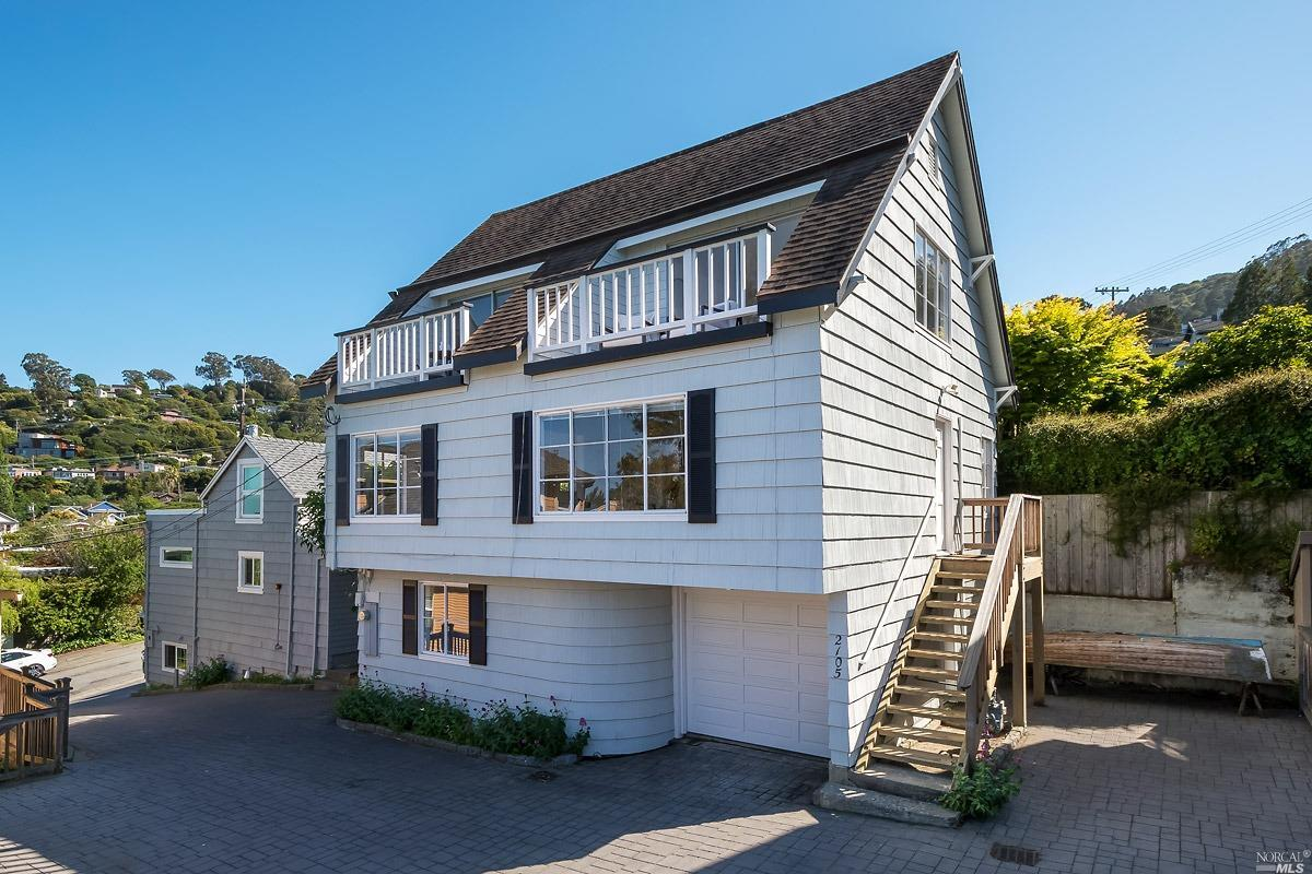 Enjoy views of the bay and plenty of room to relax in this well-located Sausalito townhome that lives like a single family house, with no shared walls and a one-car, attached garage. It's part of a two unit HOA with no monthly dues, and while the address is on Bridgeway the home is set back behind the front house with access via Olive Street, so it's buffered from the road but just moments from restaurants and stand-up paddleboarding, with Mollie Stone's Market and Caledonia street just a few blocks away. The two bedrooms on the top level each have private, sunny balconies with beautiful bay views, and there's a big bonus area on the lower level with its own entrance that would make a great guest, workout, or work-from-home space. Other features include a formal dining room, three full baths, and one additional off-street parking space. It's the perfect location to enjoy the Sausalito lifestyle with a great SF commute via car, bus, or ferry!