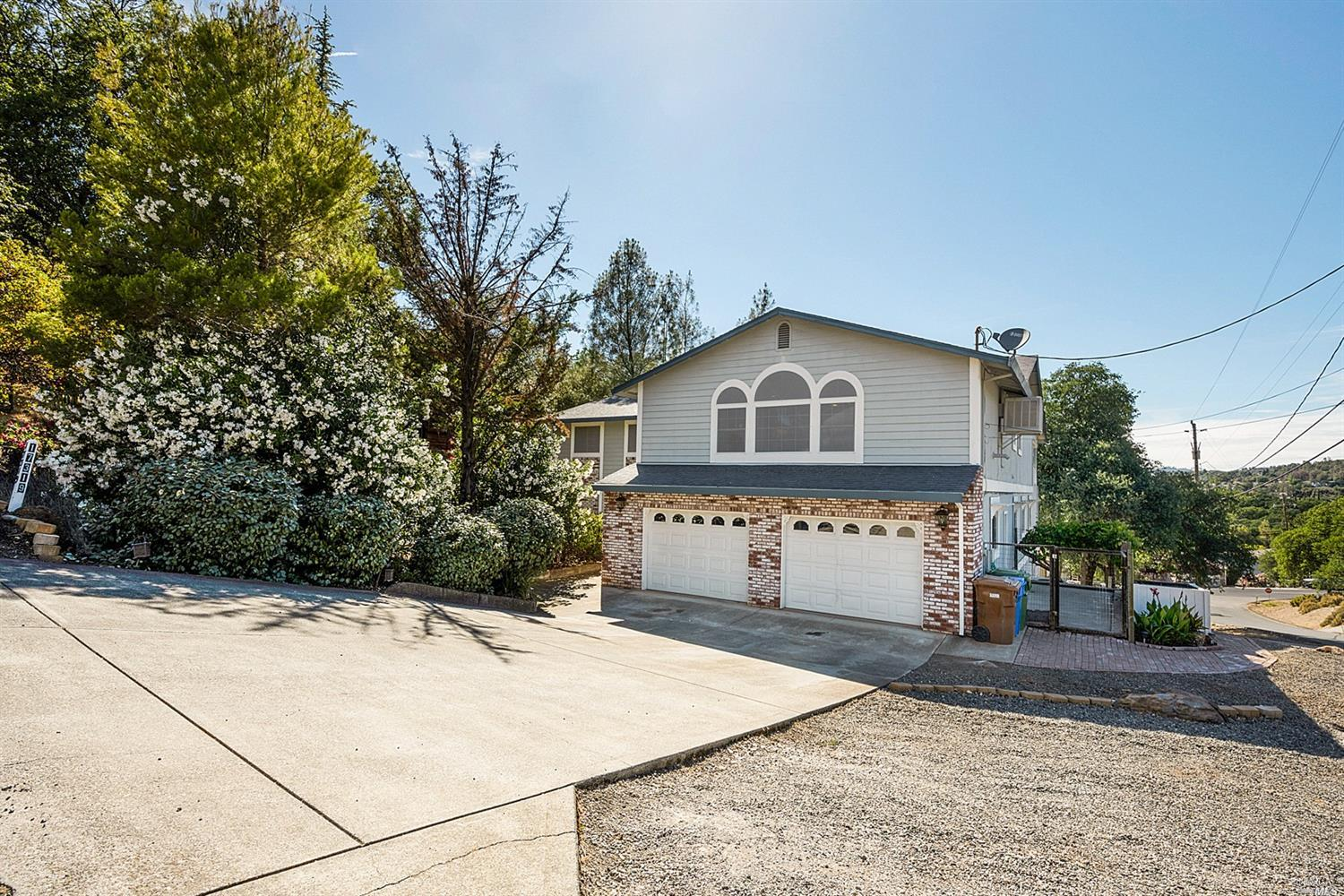 Beautiful Hidden Valley Lake home w/lake view. Tastefully decorated w/huge windows & inviting floor plan lends this to be a great home for entertaining.3 generous sized bedrooms + office and 2.5 bathrooms upstairs w/spacious L/D/F rooms,large kitchen with SS appliances & granite countertops.As well,a covered porch that runs the length of the home is right off the dining room for ease w/bbq,or eating outside & enjoying the view.Downstairs has 2 more bedrooms, 1 full bathroom with living area that was added on in 2006.Downstairs area could easily be used as separate living space for income or in-law quarters.Huge pantry was added w/laundry chute directly to the laundry room downstairs.Inside has newer water resistant wood laminate flooring an