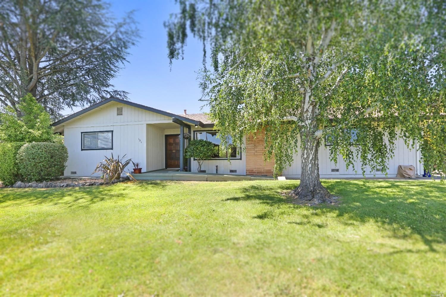 Move-in ready single story, 2 bedroom, 2 bath, home in Sonoma located in the desirable 55+ community of Temelec & uniquely situated, as it backs up to a spacious greenbelt area. Open floor plan with 1,346 sq ft of living area. A cozy breakfast room with double pantries, as well as a formal dining room, both with sliding doors that lead to an outdoor covered deck and courtyard where you can relax and enjoy the lush backyard. The living room has a gas-starter fireplace & lots of natural light. An extra bonus is the large indoor laundry room, perfect for use as an exercise room, home office or art studio and conveniently situated off the breakfast room & the 2 car garage. HOA's give you access to Historic Temelec Hall, community pools & walking trails along the vineyards. The Sonoma Plaza, fine dining and wineries are all only minutes away. Yes, you can live in Sonoma affordably and still check off all your boxes!