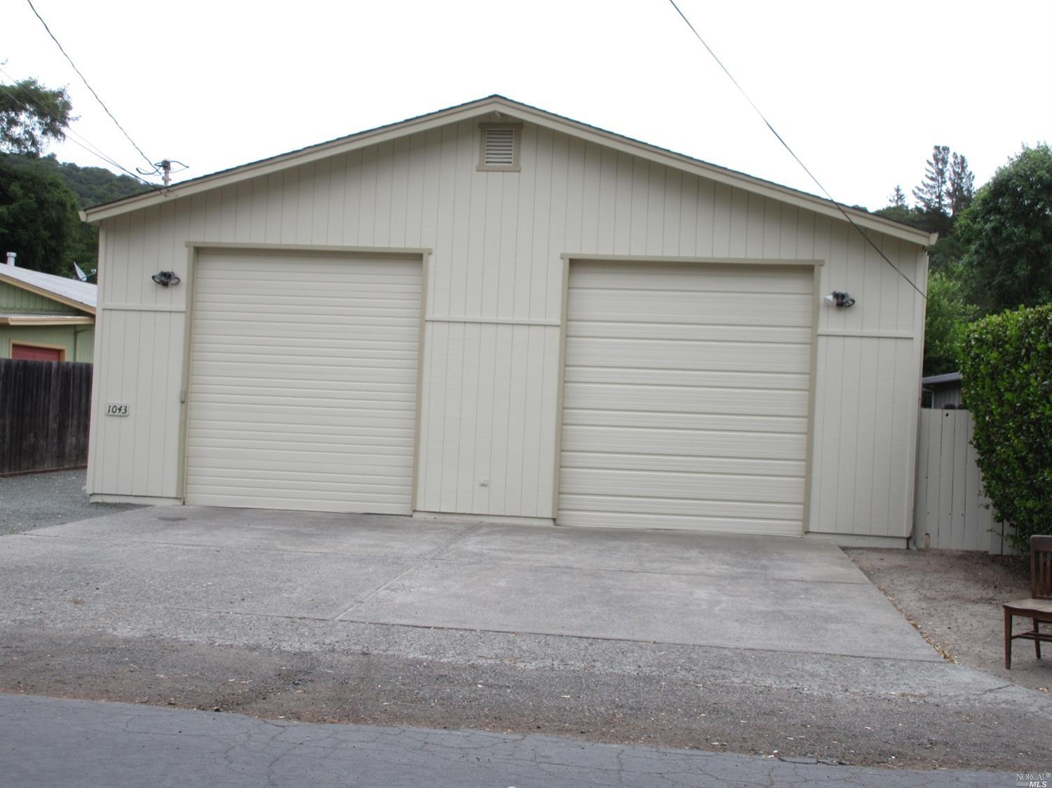 Excellent amount of floor space for the money. Although online records show 3 bedrooms only 2 are likely deemed as suitable bederooms by many observers.  Master bedroom has a huge amount of closet space. Bathrooms renovated, home fully repainted interior and exterior, ramp to front door for possible locomotor challenged buyer, two waterheaters, newer AC and Furnace. Kitchen appliances all servaceable.  New hood and dishwashwer.Covered deck off Kitchen on South Side of Home.  Two huge garage bays fully separated with separate lockable side entrances and key pad access automatic overhead doors.  Ideal for contractor or small business storage.  Both home and pest inspections have been conducted w/much of the work recommended completed by owner & attached.  However, Buyer must conduct own inspections to verify that the properties condition is suitable for the Buyer's purposes. Operability of central vacuum system unknown. Home is offered strictly AS-IS with offers recviewed as received.