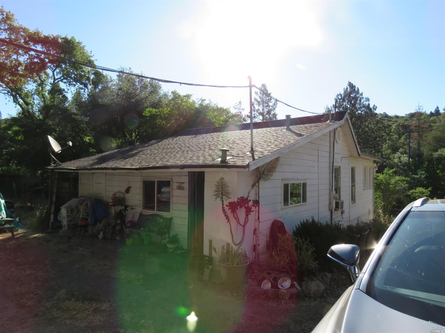 This two bedroom, one bathroom farm style home is located just minutes from downtown Sonoma. This property features over an acre of land and a charming barn. You will love this lot full of trees and opportunities. The residence itself is in need of upgrades. Location, Location, Location.