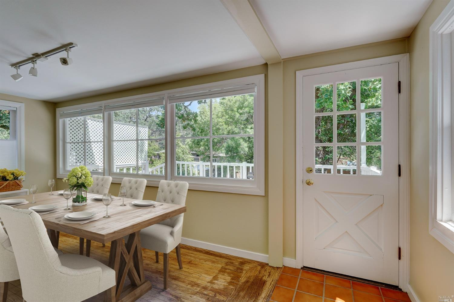 Vintage charm accentuates this Sonoma Springs home offering hardwood floors, stone fireplace, updated kitchen and baths. Sunroom that can be used as a dining area or artist room that flows onto the sunny deck. Dont miss the lower level area for  added square footage offering  a spacious/flexible floor plan that can be used as office or media room. Downstairs has laundry an additional full bath, one car garage. Nice backyard for gardening and entertaining. Near Sonoma Regional Park hiking, wineries, restaurants, movie theater and boutiques. This is an excellent weekend get away or full time wine country Sonoma Valley home.