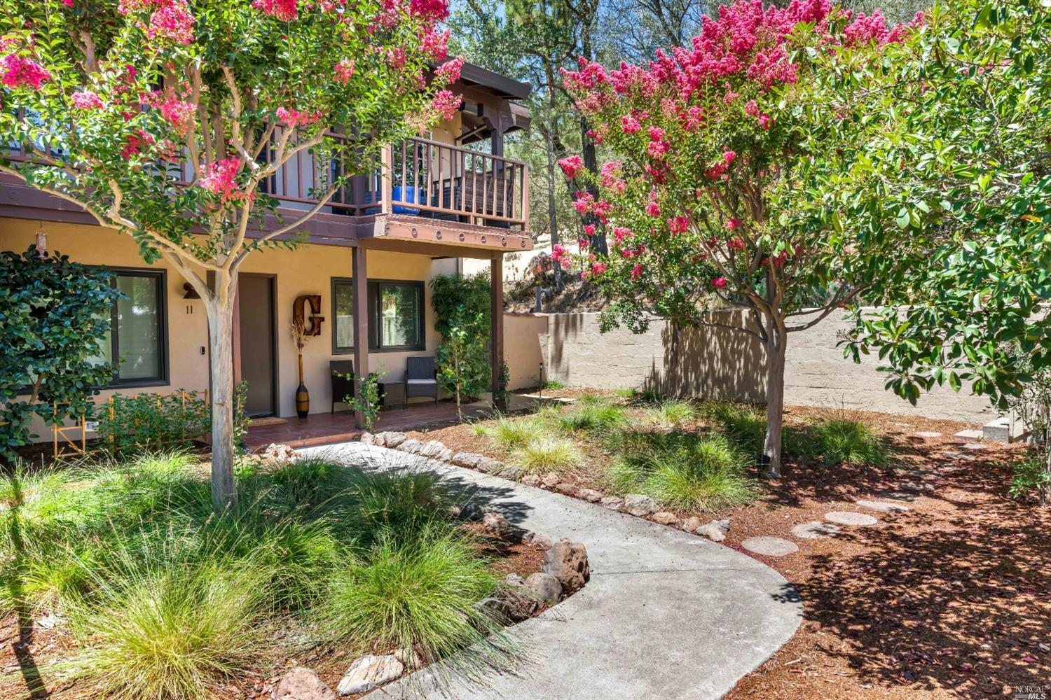 Short walk to the Sonoma Plaza, restaurants, wineries & hiking trails. Newly-renovated modern farmhouse condo has all the luxuries of Sonoma-living. This Eastside 2 bed, 2 bath home has been recently updated; new bathrooms, flooring, windows & coverings, doors, countertops, washer/ventless dryer, lighting, EV Charging in carport, among many other upgrades. The living room features a new gas fireplace w/gorgeous stone surround & custom shelving w/display space & a bar area w/wine refrigerator. The pristine modern kitchen complete w/stainless steel appliances features a new Calacatta quartz waterfall countertop w/bar seating, new cabinets, open shelving & a copper farmhouse sink. The dining area leads to an outdoor patio, ideal to BBQ & dine outdoors. Designed for indoor/outdoor living, the newly landscaped yard is your own oasis nestled at the foot of the Sonoma Overlook Trail w/hiking access. Perfectly situated at the end of an all-age complex, nearby field & hillside for privacy. #11