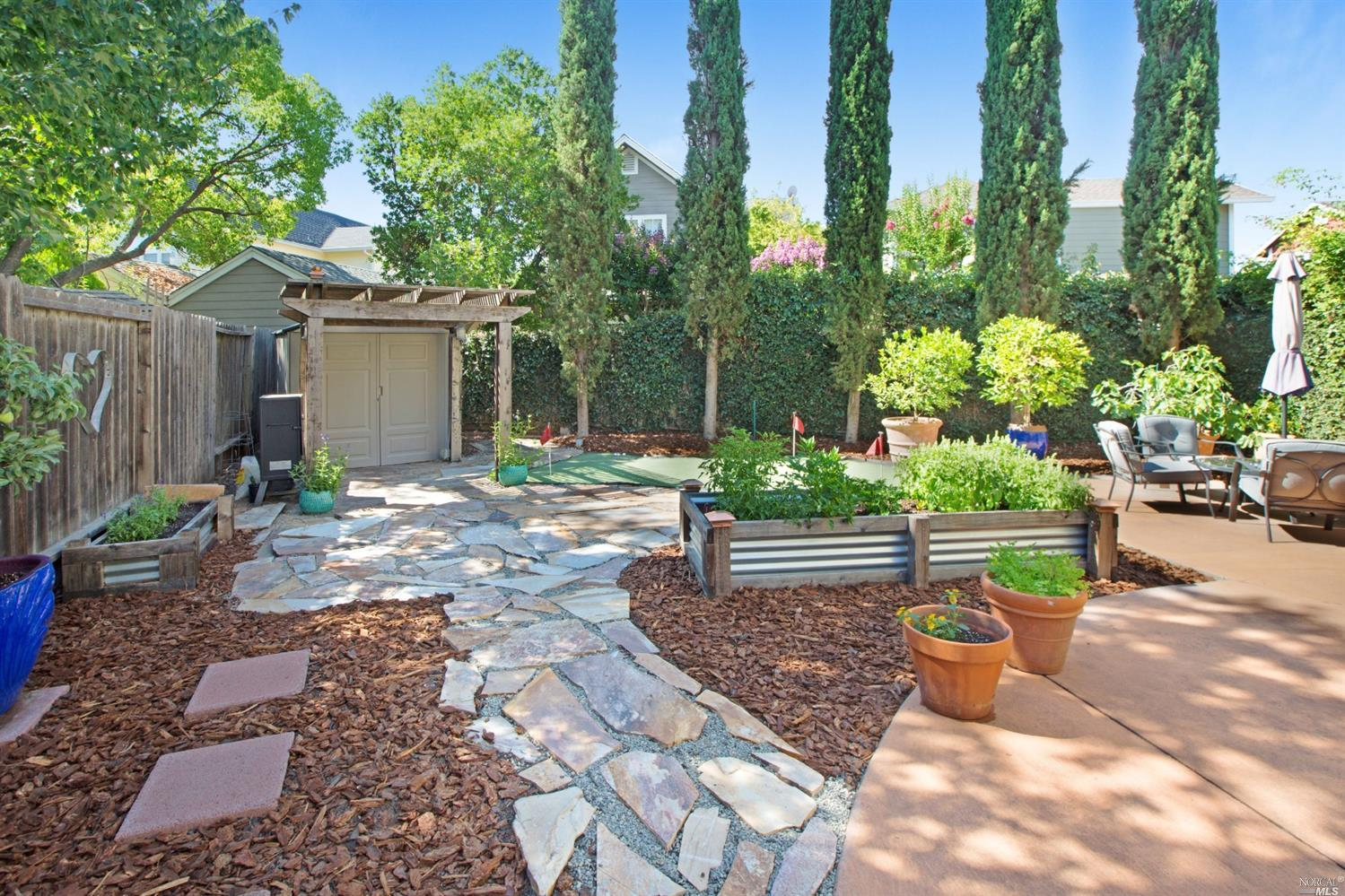 Ideally located so close to the Sonoma Plaza!  This beautiful, turn-key home is just perfect for  full time living or vacationing. Pretty mountain views from the upper balcony. Relax or entertain in the tastefully landscaped rear garden - complete with a putting green, fruit trees, patio & raised herb beds. Contemporary, loads of light, high ceilings, skylight, and two master suites with jetted tub in the master bathroom. This home is crisp and clean with tile and wood laminate floors, and updates throughout. The living room includes a fireplace and glass door opening to the rear garden, and the dining area opens to a wonderful, light filled atrium which could be used as an office, art studio, more.  Lovely kitchen with granite countertops and stainless appliances. Laundry room, reserved parking. Great opportunity to enjoy a convenient and comfortable downtown Sonoma lifestyle.