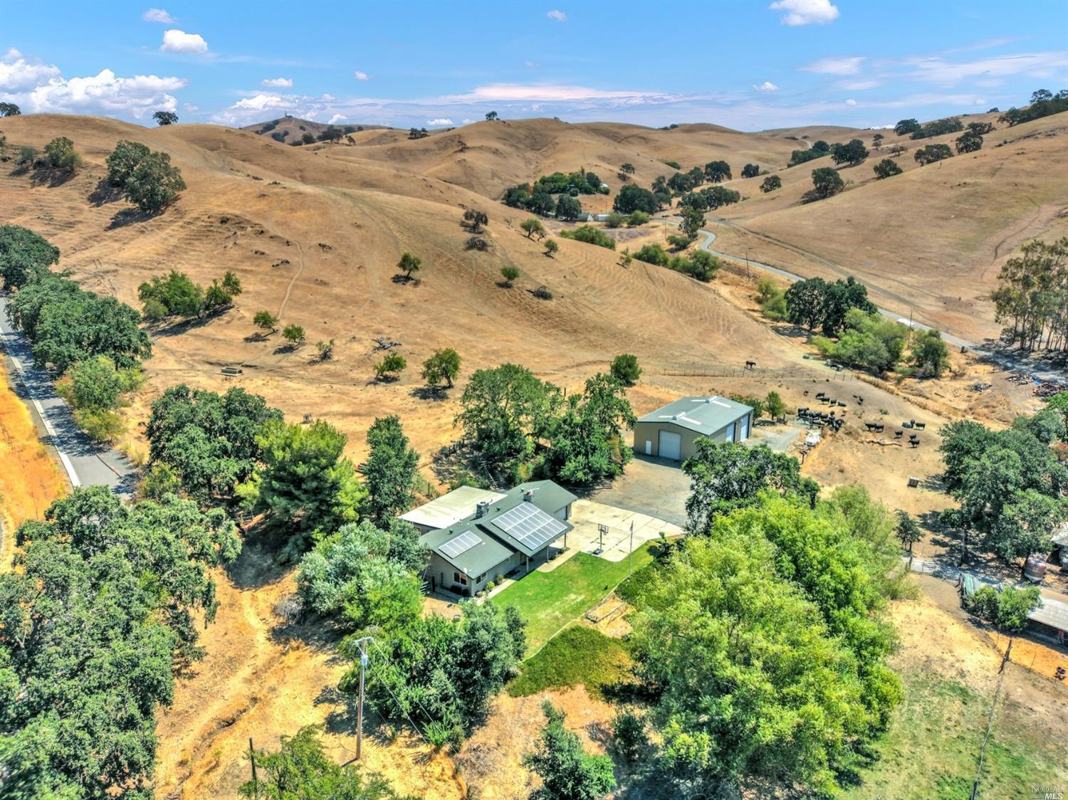 Exclusive opportunity to experience large ranch living in a private Paradise Valley location, only minutes to town. In addition to your own 44.9-acres, you will have 1/3 ownership on a 146.58-acre parcel which also is open grazing land with special views, ponds, oaks and privacy. Spectacular land showcases rolling hills, open grazing pastures, seasonal creeks, ponds and many large oak trees. Per the owner, dove, deer, wild turkey and quail hunting is excellent. Enjoy quads, hiking, horseback, camping and picnicking in your private paradise. Single-story home on the property offers owned solar, dual pane windows and kitchen with granite counters and gas range. Property has a huge 40x60 ft workshop. Location is approx. halfway between San Fra