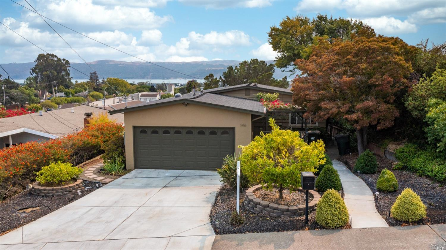 A classic Benicia beauty with gorgeous views of the water. Located just a short walk from downtown, grocery stores, bars, restaurants, city park, and shopping. Enjoy the views on your large deck, perfect for entertaining and relaxing. The home has a lovely open floorpan, updated throughout, beautiful hardwood floors, air conditioning, tankless water heater, and a large lot. Don't miss the handful of fruit trees, including avocado and Meyer lemon. Close proximity to the highway for ease of transportation.