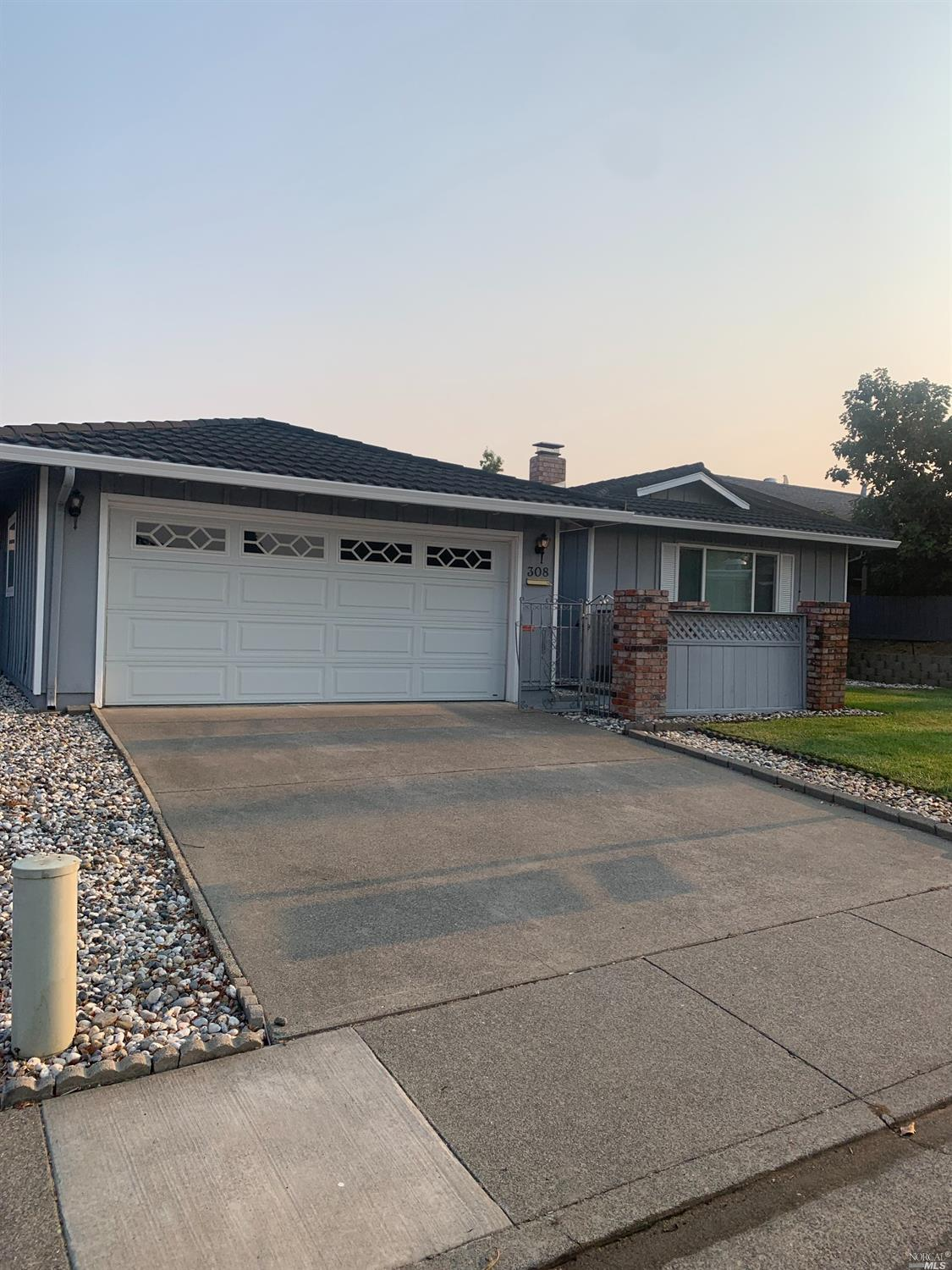 Well kept 3 bedroom 2 bath home with detached 2 car garage. Kitchen has been remodeled with granite