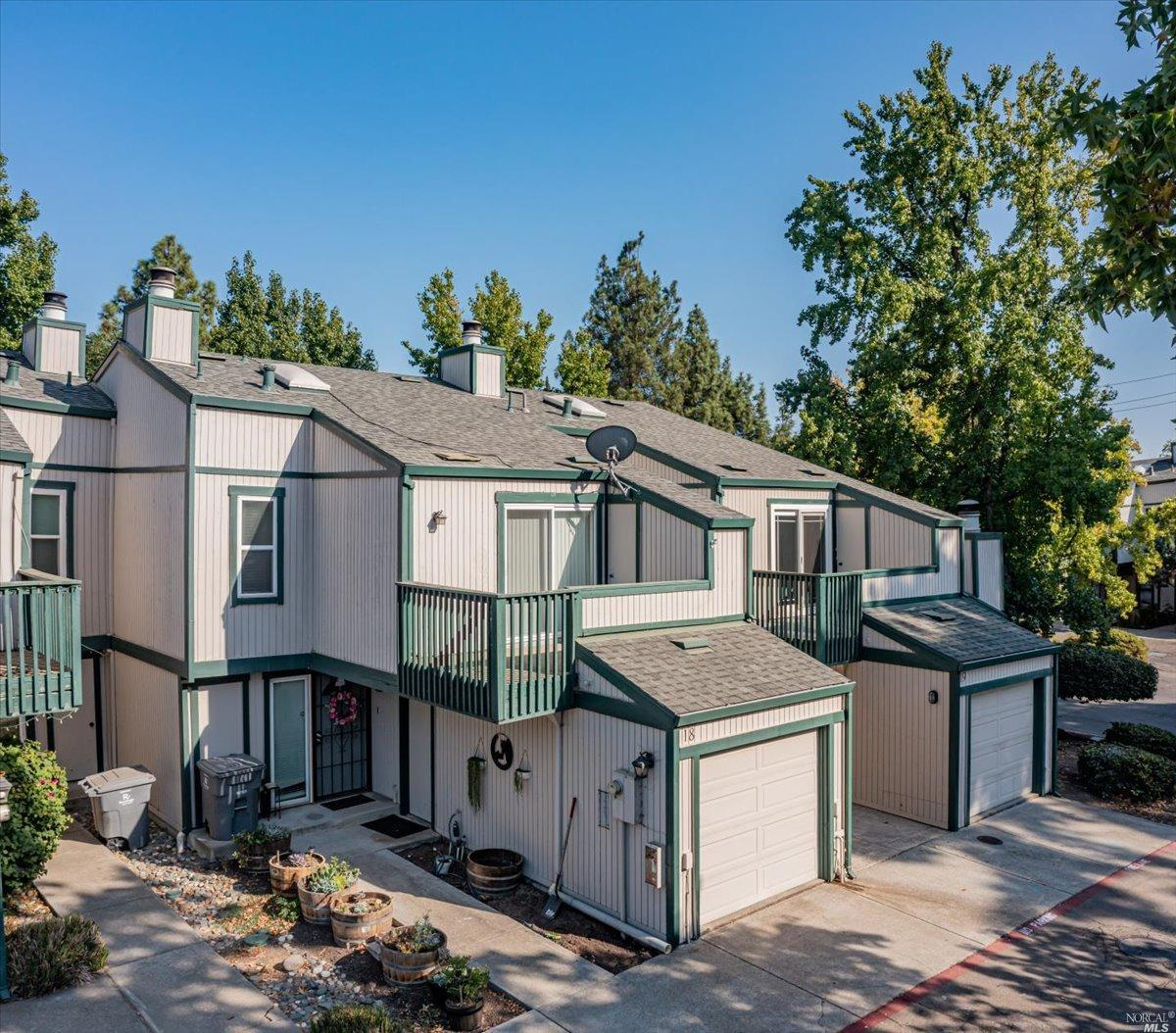 Beautiful Townhome in Shasta Park. The offering includes newer stainless steel appliances, central heat and air, dual paned windows, wide plank floors and fully fenced private back patio. The floorplan is welcoming with a large open living room that features a wood burning fireplace, formal dining area, and half bathroom on the main floor. Exceptional walk-in closet in and ensuite bathroom in the primary suite makes a nice retreat with private balcony. 1 car garage grants extra room for parking or storage. The community also offers two swimming pools, sports court and entry gate.