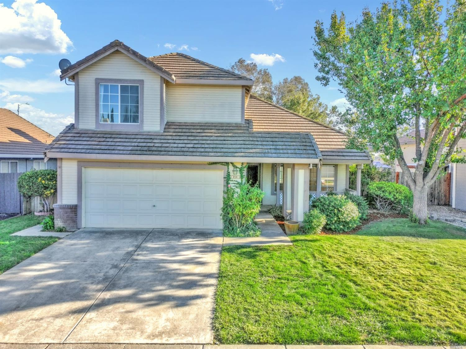 This is a beautifully remodeled five bedroom, three bath home, with vaulted ceilings, and no rear ne